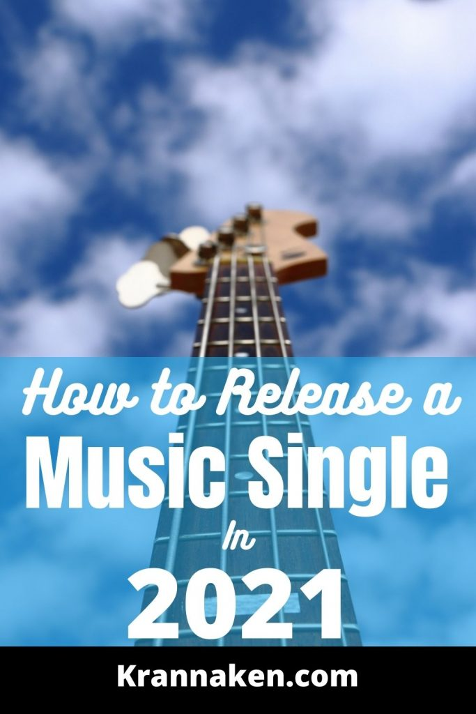 This Pinterest pin is a bass guitar in front of a cloudy blue sky with the post title how to release a music single in 2021 towards the bottom.